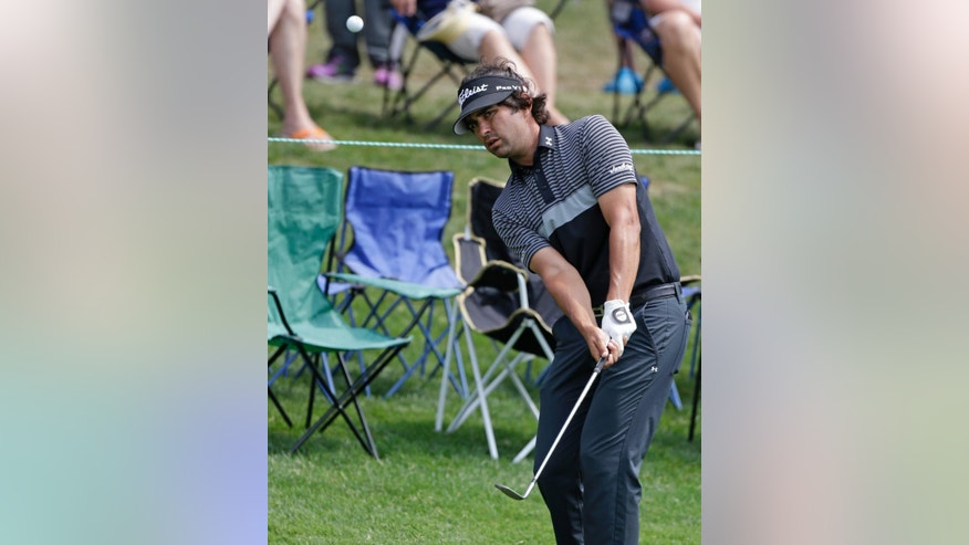 Martin Flores chips to the 15th green during the second round of the Wells Fargo Championship golf tournament at Quail Hollow Club in Charlotte, N.C., Friday, May 15, 2015. (AP Photo/Bob Leverone)