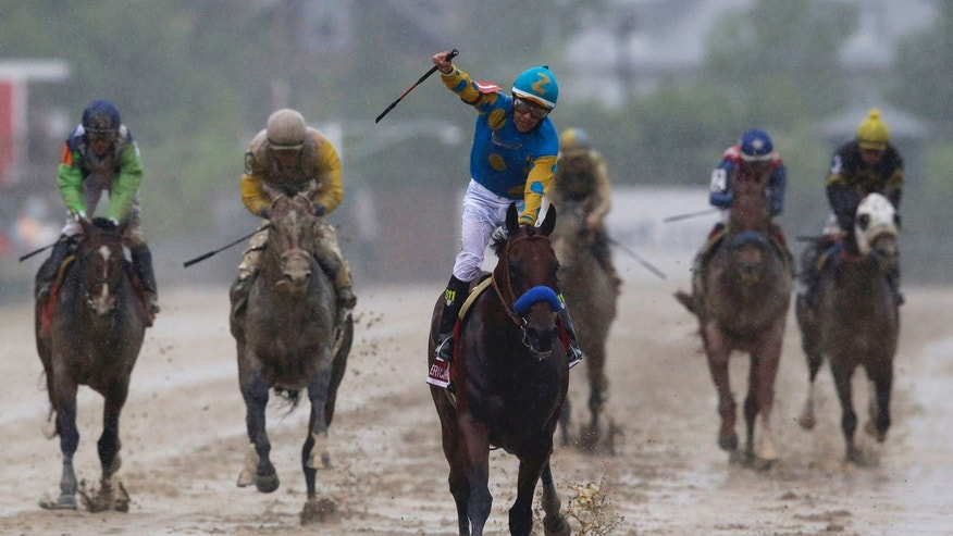 May 16, 2015: American Pharoah, ridden by Victor Espinoza, center, wins the 140th Preakness Stakes horse race at Pimlico Race Course in Baltimore. (AP)