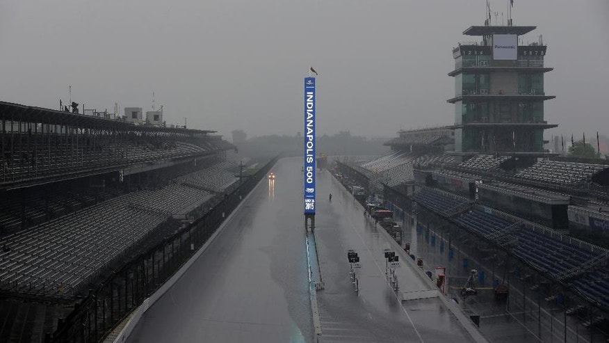 The scoring pylon is lit along the main straight as rain closed the tract for the day on the first day of qualifications for the Indianapolis 500 auto race at Indianapolis Motor Speedway in Indianapolis, Saturday, May 16, 2015.  (AP Photo/AJ Mast)