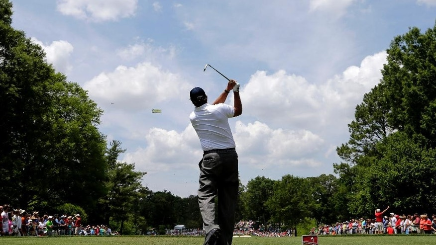Phil Mickelson watches his tee shot on the second hole during the third round of the Wells Fargo Championship golf tournament at Quail Hollow Club in Charlotte, N.C., Saturday, May 16, 2015. (AP Photo/Chuck Burton)