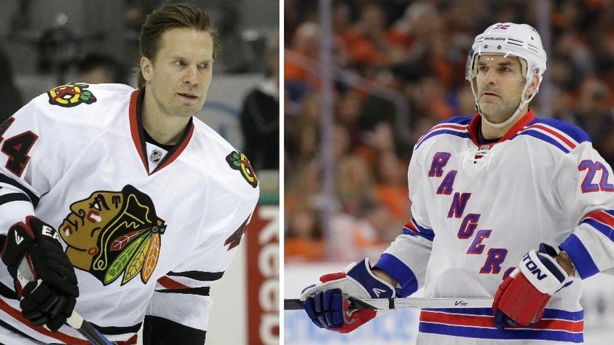 ADVANCE FOR WEEKEND EDITIONS, MAY 15-17 - FILE - At left, in a March 21, 2015, file photo, Chicago Blackhawks defenseman Kimmo Timonen (44) skates  during warms ups before an NHL hockey game  in Dallas. At right, in a Feb. 28, 2015, file photo, New York Rangers' Dan Boyle skates during an NHL hockey game against the Philadelphia Flyers in Philadelphia. Eight of Anaheim's best players are 24 or younger, and Tampa Bay has the youngest remaining player in the NHL playoffs in 20-year-old winger Jonathan Drouin. The Blackhawks counter with 20-year-old forward Teuvo Teravainen, and the oldest remaining player in 40-year-old defenseman Kimmo Timonen. The Rangers have seasoned veterans Martin St. Louis and Dan Boyle. (AP Photo/File)