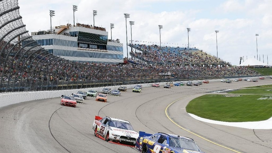 Chase Elliott, right, races ahead of Ryan Blaney during the NASCAR Xfinity Series auto race, Sunday, May 17, 2015, at Iowa Speedway in Newton, Iowa. (AP Photo/Charlie Neibergall)