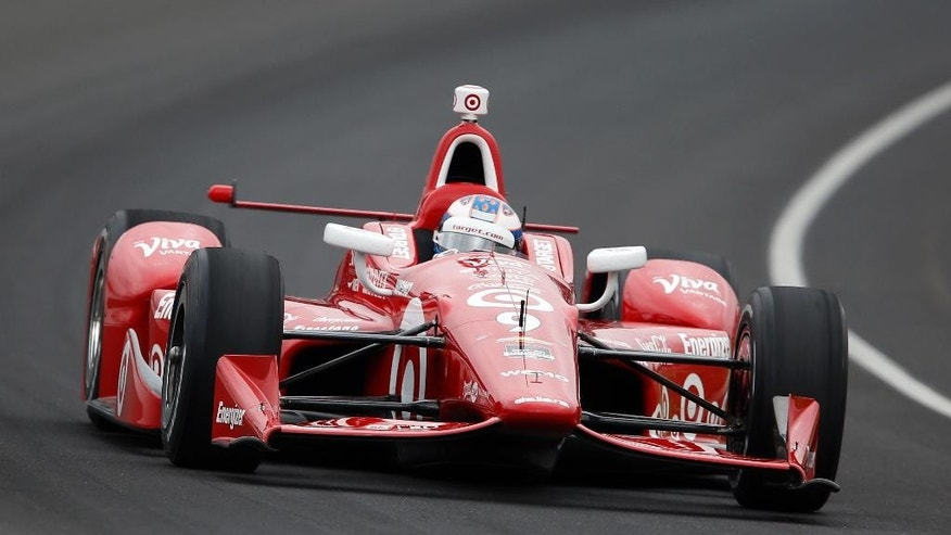 Scott Dixon, of New Zealand, drives through the first turn during practice before qualifications for the Indianapolis 500 auto race at Indianapolis Motor Speedway in Indianapolis, Sunday, May 17, 2015.  (AP Photo/Sam Riche)