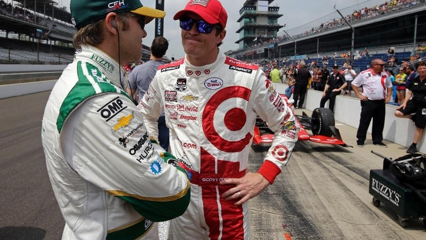 Ed Carpenter, left, and Scott Dixon, of New Zealand, talk as they wait for the start of qualifications for the Indianapolis 500 auto race at Indianapolis Motor Speedway in Indianapolis, Sunday, May 17, 2015. (AP Photo/Darron Cummings)
