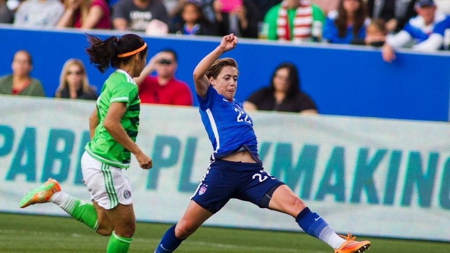 United States' defender Meghan Klingenberg, right, tries to control a ball against Mexico's defender Kenti Robles during the first half of their friendly soccer match, Sunday, at StubHub Center? in Carson, Calif. (AP Photo/Ringo H.W. Chiu)