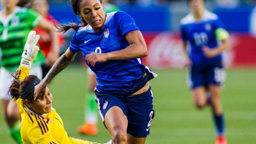 United States' forward Sydney Leroux, right, dives the ball past Mexico's goalkeeper Cecilia Santiago during the first half of their friendly soccer match, Sunday,  May 17, 2015, at StubHub Center? in Carson, Calif. (AP Photo/Ringo H.W. Chiu)