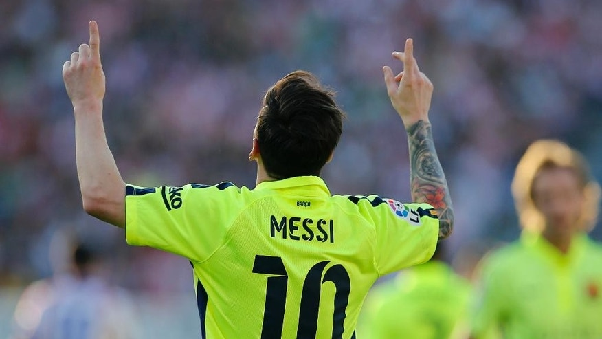 Barcelona's Lionel Messi celebrates after scoring a goal during a Spanish La Liga soccer match between Atletico Madrid and Barcelona at the Vicente Calderon stadium in Madrid, Spain, Sunday May 17, 2015. (AP Photo/Paul White)