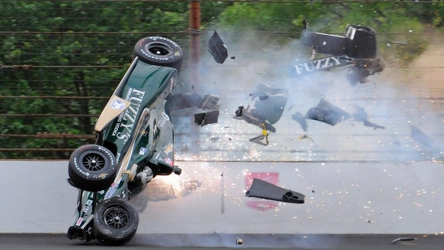 Ed Carpenter hits the wall in the second turn during practice before qualifications for the Indianapolis 500 auto race at Indianapolis Motor Speedway in Indianapolis, Sunday, May 17, 2015.  Carpenter walked away from the crash and has been released from he track hospital after being checked. (AP Photo/Jamie Gallagher)