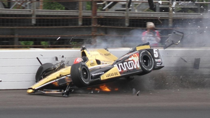 James Hinchcliffe, of Canada, hits the wall in the third turn during practice for the Indianapolis 500 auto race at Indianapolis Motor Speedway in Indianapolis, Monday, May 18, 2015.  (Jimmy Dawson/The Indianapolis Star via AP)