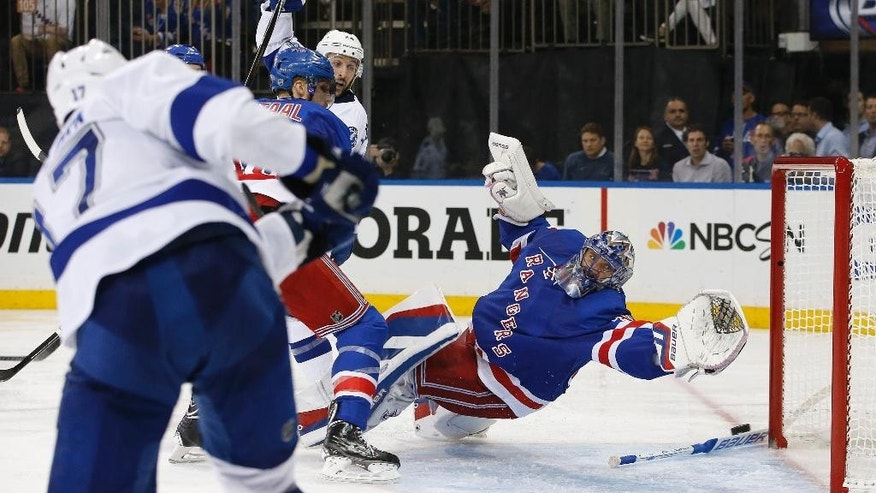 Tampa Bay Lightning center Alex Killorn (17) shoots and scores past New York Rangers goalie Henrik Lundqvist, right, during the third period of Game 2 of the Eastern Conference final during the NHL hockey Stanley Cup playoffs, Monday, May 18, 2015, in New York. (AP Photo/Kathy Willens)