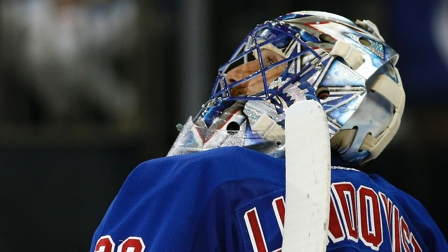 New York Rangers goalie Henrik Lundqvist  looks up at the scoreboard after a goal by the Tampa Bay Lightning during the second period of Game 2 of the Eastern Conference final during the NHL hockey Stanley Cup playoffs, Monday, May 18, 2015, in New York. (AP Photo/Kathy Willens)