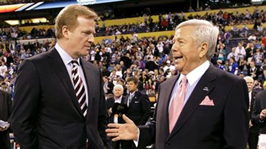 In this Feb. 5, 2012, file photo, NFL Commissioner Roger Goodell, left, talks with New England Patriots Chairman and CEO Robert Kraft before the NFL Super Bowl XLVI football game between the New York Giants and the New England Patriots in Indianapolis.