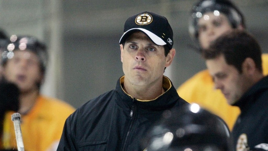 FILE - In this July 9, 2007,  file photo, Boston Bruins director of player development Don Sweeney, center, watches play during a hockey team development camp in Wilmington, Mass. The Bruins announced Wednesday, May 20, 2015, Sweeney has been elevated to general manager, taking over for his former boss, Peter Chiarelli, who was fired in April after the team missed the playoffs for the first time in eight years. (AP Photo/Charles Krupa, File)