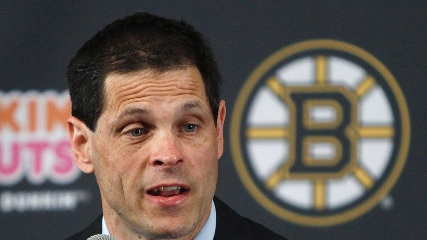 Boston Bruins general manager Don Sweeney speaks after being introduced Wednesday, May 20, 2015, in Boston. Sweeney was elevated to general manager, taking over for his former boss, Peter Chiarelli, who was fired in April after the team missed the playoffs for the first time in eight years. (AP Photo/Bill Sikes)