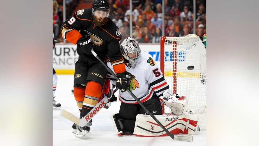 Chicago Blackhawks goalie Corey Crawford, right, blocks a shot by Anaheim Ducks left wing Patrick Maroon during the second period of Game 2 of the Western Conference final during the NHL hockey Stanley Cup playoffs in Anaheim, Calif., on Tuesday, May 19, 2015. (AP Photo/Mark J. Terrill)
