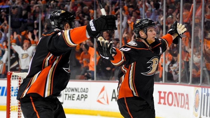 Anaheim Ducks right wing Corey Perry, right, celebrates after scoring with left wing Patrick Maroon against the Chicago Blackhawks during the second period of Game 2 of the Western Conference final during the NHL hockey Stanley Cup playoffs in Anaheim, Calif., on Tuesday, May 19, 2015. (AP Photo/Mark J. Terrill)