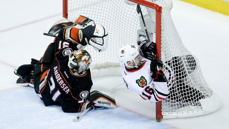 Chicago Blackhawks center Marcus Kruger, right, collides with the net as Anaheim Ducks goalie Frederik Andersen looks on during the second period of Game 2 of the Western Conference final during the NHL hockey Stanley Cup playoffs in Anaheim, Calif., on Tuesday, May 19, 2015. (AP Photo/Jae C. Hong)