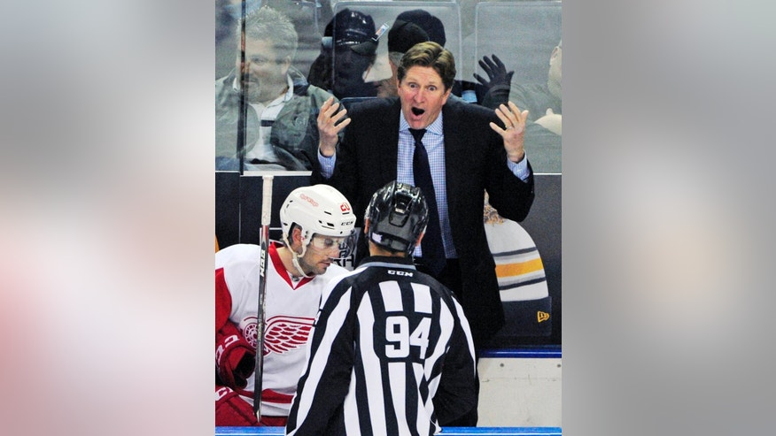 FILE - In this Nov. 2, 2014, file photo, Detroit Red Wings head coach Mike Babcock argues a call to NHL linesman Bryan Pancich during the overtime session of an NHL hockey game against the Buffalo Sabres in Buffalo, N.Y. The Toronto Maple Leafs have hired Mike Babcock as their new head coach, Wednesday, May 20, 2015. (AP Photo/Gary Wiepert, File)