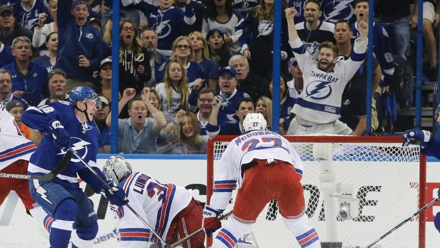 Tampa Bay Lightning left wing Ondrej Palat (18), of the Czech Republic, watches his shot go in the goal past New York Rangers goalie Henrik Lundqvist (30), of Sweden, during the third period of Game 3 of the Eastern Conference finals in the NHL hockey Stanley Cup playoffs Wednesday, May 20, 2015, in Tampa, Fla. Rangers defenseman Ryan McDonagh is at right. (AP Photo/Chris O'Meara)
