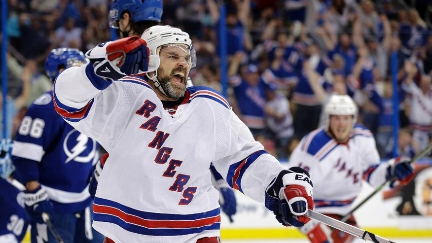 New York Rangers defenseman Dan Boyle (22) celebrates his game-tying goal during the third period of Game 3 of the Eastern Conference finals against the Tampa Bay Lightning in the NHL hockey Stanley Cup playoffs Wednesday, May 20, 2015, in Tampa, Fla. (AP Photo/Chris O'Meara)