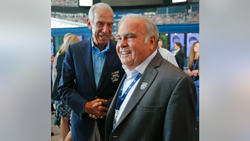 Jerry Cook, right, is congratulated by Hall of Fame driver Ned Jarrett, left, after being named to the 2016 class of the NASCAR Hall of Fame during an announcement at the NASCAR Hall of Fame in Charlotte, N.C., Wednesday, May 20, 2015. (AP Photo/Terry Renna)