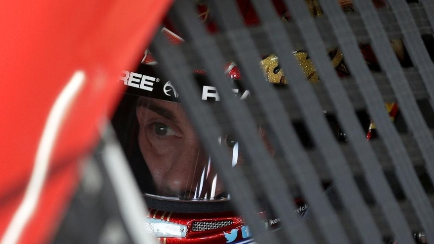 Kevin Harvick waits in his car before practice for Sunday's NASCAR Coca-Cola 600 Sprint Cup series auto race at Charlotte Motor Speedway in Concord, N.C., Thursday, May 21, 2015. (AP Photo/Chuck Burton)