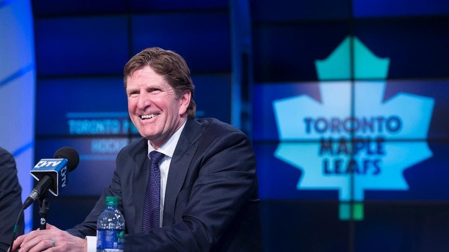 Toronto Maple Leafs' new head coach Mike Babcock laughs during an NHL hockey press conference in Toronto, Thursday, May 21, 2015.  Babcock spent the last 10 seasons with the Detroit Red Wings, where he won the Stanley Cup in 2008. (Darren Calabrese/The Canadian Press via AP) MANDATORY CREDIT