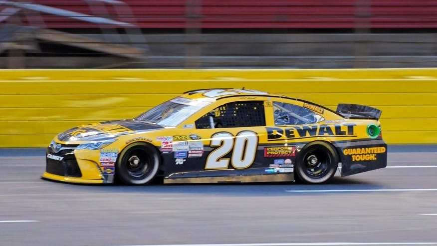 Matt Kenseth drives his car during qualifying for Sunday's NASCAR Sprint Cup series auto race at Charlotte Motor Speedway in Concord, N.C., Thursday, May 21, 2015. Kenseth won the pole position for the race. (AP Photo/Mike McCarn)