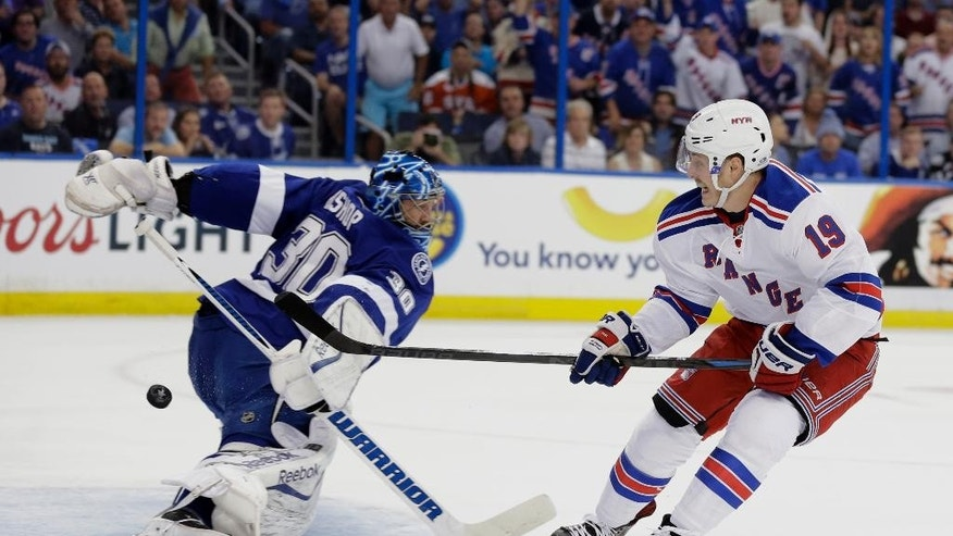 New York Rangers right wing Jesper Fast (19), of Sweden, watches his shot go past Tampa Bay Lightning goalie Ben Bishop (30) for a goal during the first period of Game 3 of the NHL hockey Stanley CUp Eastern Conference finals Wednesday, May 20, 2015, in Tampa, Fla. (AP Photo/Chris O'Meara)