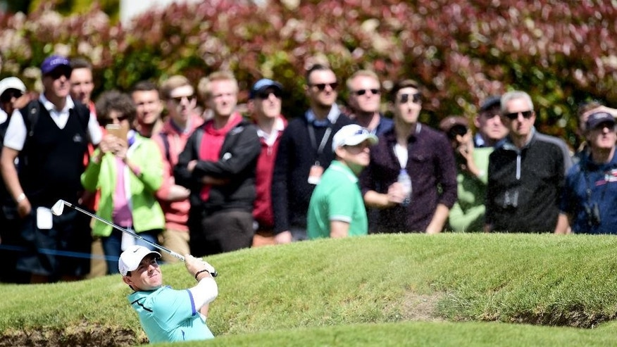 World number one Northern Ireland's Rory McIlroy plays out of a bunker during day one of the 2015 BMW PGA Championship at the Wentworth Golf Club, Virginia Water,  England Thursday May 21, 2015. (Adam Davy/PA via AP) UNITED KINGDOM OUT