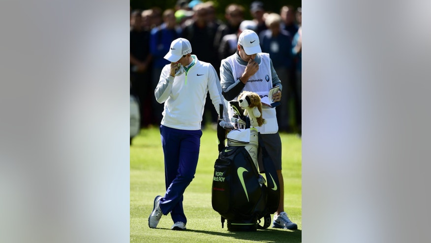 Northern Ireland's Rory McIlroy waits to play with his caddie JP Fitzgerald, right, during day one of the BMW PGA Championship at Wentworth golf club, Virginia Water, England, Thursday May 21, 2015. (Adam Davy/PA via AP) UNITED KINGDOM OUT  NO SALES  NO ARCHIVE