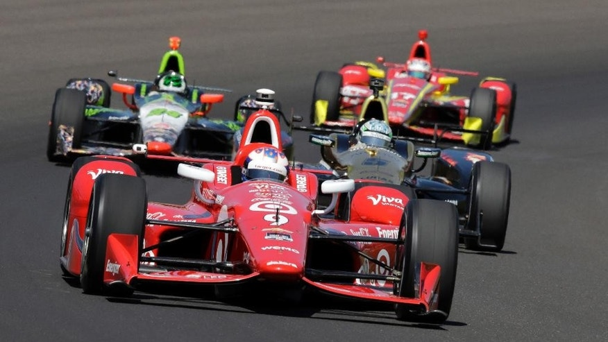 Scott Dixon, of New Zealand, drives through the first turn during the final practice session for the Indianapolis 500 auto race at Indianapolis Motor Speedway in Indianapolis, Friday, May 22, 2015.  (AP Photo/R Brent Smith)