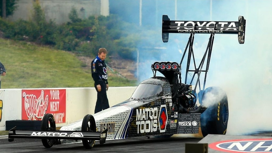 Antron Brown does a burnout during a Top Fuel session at NHRA Kansas Nationals drag races Friday May 22, 2015, at Heartland Park in Topeka, Kan. Brown finished the day as the top qualifier. (Chris Neal/Topeka Capital-Journal via AP)