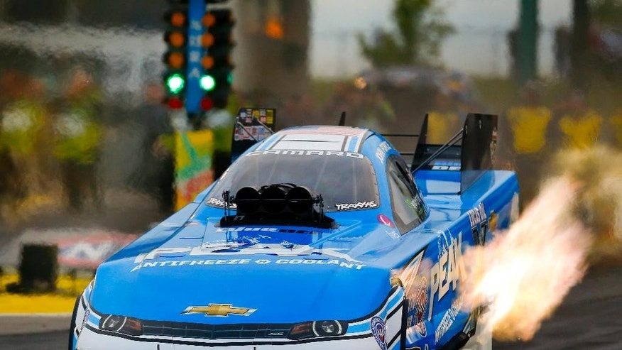 Funny Car driver John Force tears down the track during the second run of the 2015 NHRA Kansas Nationals, Friday May 22, 2015, at Heartland Park in Topeka, Kan. (Chris Neal/The Topeka Capital-Journal via AP)