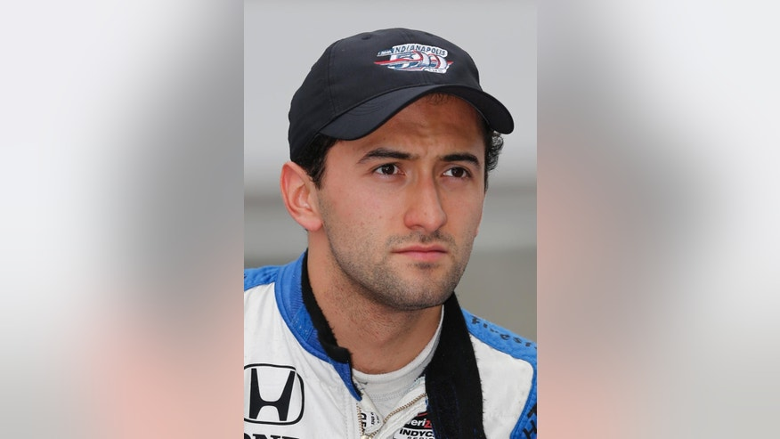 "In this May 16, 2015,  photo, Carlos Huertas, of Colombia, is shown after he qualified for the Indianapolis 500 auto race at Indianapolis Motor Speedway in Indianapolis. Huertas has been ruled out of the Indianapolis 500 two days before the race after he was diagnosed with an ""inner ear condition"" and failed to pass a medical exam. (AP Photo/Dave Parker)"