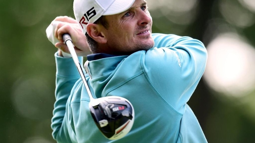 England's Justin Rose plays a shot during day two of the BMW PGA Championship at the Wentworth golf club, Virginia Water, England, Friday May 22, 2015. (Adam Davy/PA via AP) UNITED KINGDOM OUT  NO SALES  NO ARCHIVE
