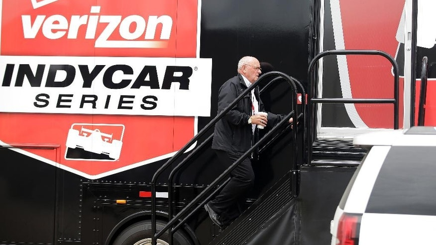 FILE - In this May 18, 2015, file photo, Derrick Walker, President of operations and competition of IndyCar, walks into the IndyCar operations trailer following the crash of James Hinchcliffe, of Canada, during practice for the Indianapolis 500 auto race at Indianapolis Motor Speedway in Indianapolis. Derrick Walker might be one of the most liked officials in the IndyCar Series. He also has one of the toughest jobs. (AP Photo/Darron Cummings, File)