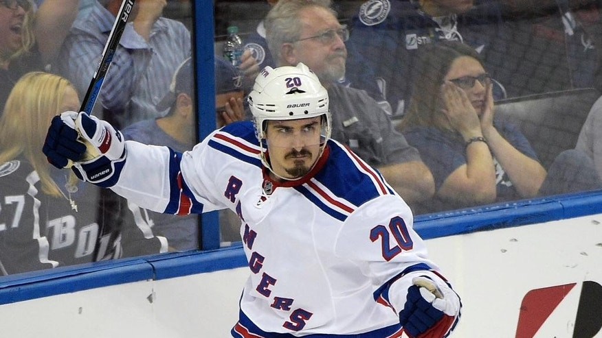 New York Rangers left wing Chris Kreider celebrates after scoring a goal during the second period of Game 4 of the Eastern Conference finals against the Tampa Bay Lightning, in the NHL hockey Stanley Cup playoffs, Friday, May 22, 2015, in Tampa, Fla. (AP Photo/Phelan M. Ebenhack)