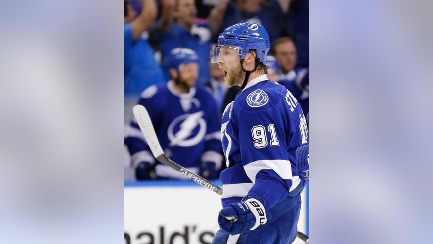 Tampa Bay Lightning center Steven Stamkos reacts after scoring a goal during the second period of Game 4 of the Eastern Conference finals against the New York Rangers, in the NHL hockey Stanley Cup playoffs, Friday, May 22, 2015, in Tampa, Fla. (AP Photo/Chris O'Meara)