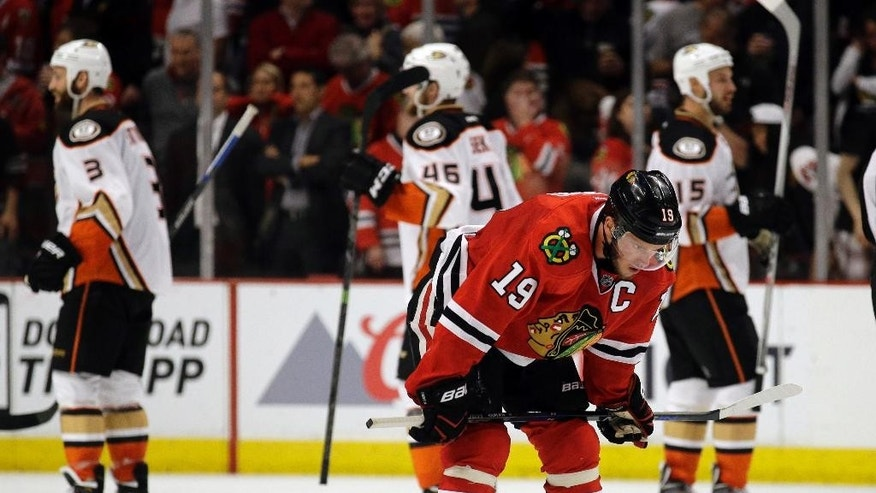 Chicago Blackhawks center Jonathan Toews (19) reacts after Game 3 of the Western Conference finals against the Anaheim Ducks in the NHL hockey Stanley Cup playoffs, Thursday, May 21, 2015, in Chicago. The Ducks won 2-1. (AP Photo/Nam Y. Huh)