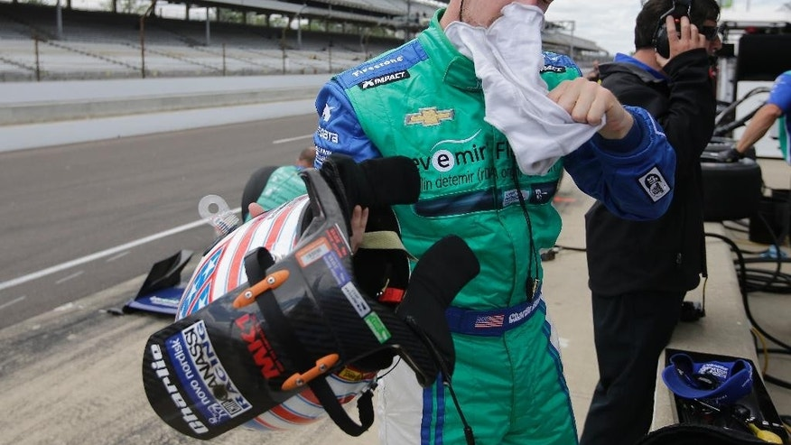 Charlie Kimball pulls off his balaclava following a practice session for the Indianapolis 500 auto race at Indianapolis Motor Speedway in Indianapolis, Tuesday, May 12, 2015.  (AP Photo/Darron Cummings)