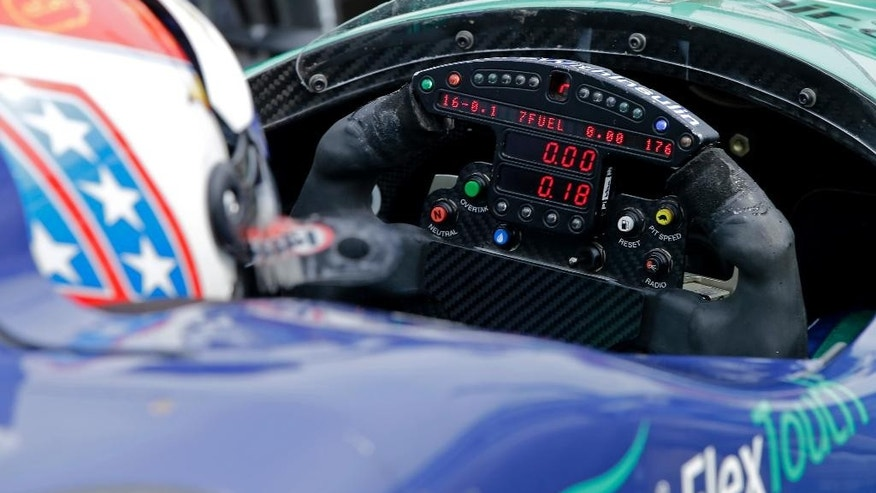 In this May 14, 2015, photo, the steering wheel of Charlie Kimball is seen during practice for the Indianapolis 500 auto race at Indianapolis Motor Speedway in Indianapolis, Thursday, May 14, 2015. Kimball checks the special monitor on his steering wheel during a race to monitor his blood-glucose level. (AP Photo/Darron Cummings)
