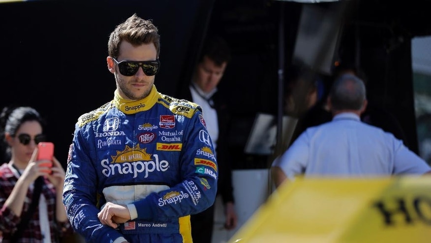 Marco Andretti looks over his car during the final practice session for the Indianapolis 500 auto race at Indianapolis Motor Speedway in Indianapolis, Friday, May 22, 2015.  (AP Photo/Darron Cummings)