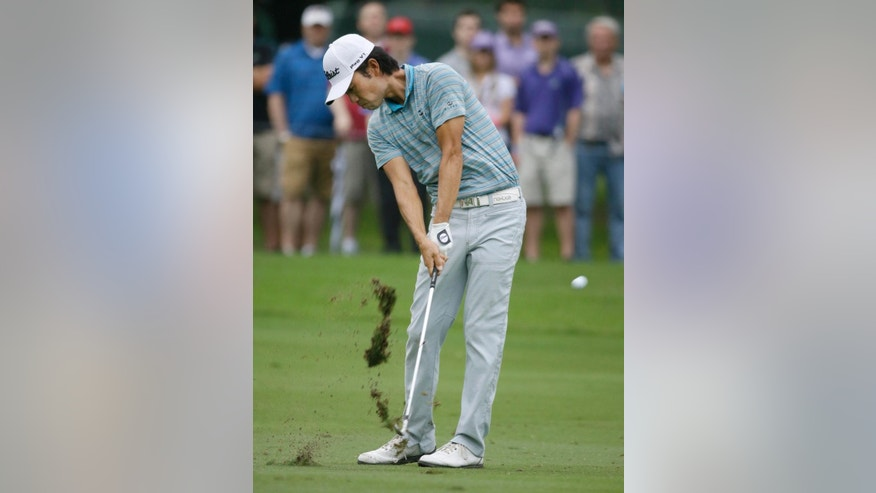 Kevin Na watch hits an approach shot on the sixth hole during the third round of the Colonial golf tournament Saturday, May 23, 2015, in Fort Worth, Texas. (AP Photo/LM Otero)