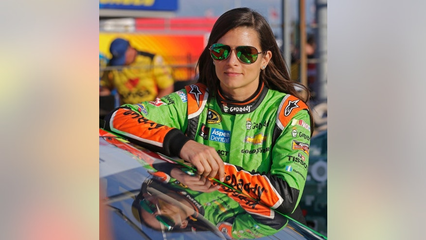 FILE - In this May 21, 2015 file photo, Danica Patrick leans against her car before qualifying for Sunday's NASCAR Sprint Cup series auto race at Charlotte Motor Speedway in Concord, N.C.  Ten years after Danicamania became a national catchphrase out of Indy, there seems to be a decided lack of talented women racers.  (AP Photo/Chuck Burton, File)