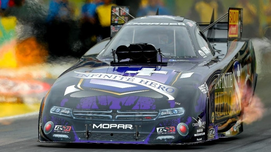 "Funny Car driver ""Fast"" Jack Beckman accelerates down the track during the quarterfinals of the 2015 NHRA Kansas Nationals on Sunday, May 24, 2015, at Heartland Park in Topeka, Kan. Beckman won the Kansas Nationals over John Force with a time of 3.982.  (Chris Neal/The Topeka Capital-Journal via AP)  MANDATORY CREDIT"