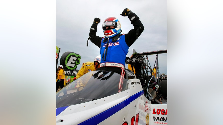 Top Fuel driver Richie Crampton pumps his fists as he climbs out of his dragster after winning the 2015 NHRA Kansas Nationals on Sunday, May 24, 2015 at Heartland Park in Topeka, Kan. Crampton defeated Larry Dixon with a time of 3.738 seconds to take home the trophy.  (Chris Neal/The Topeka Capital-Journal via AP)  MANDATORY CREDIT