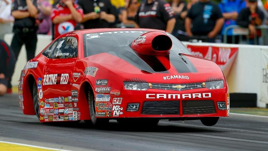 Erica Enders puts her Pro Stock car on two wheels while racing in the first round of eliminations during the 2015 NHRA Kansas Nationals on Sunday, May 24, 2015, at Heartland Park in Topeka, Kan. Enders defeated Greg Anderson to take of the Kansas Nationals trophy with a time of 6.584 at 209.33 mph.(Chris Neal/The Topeka Capital-Journal via AP)  MANDATORY CREDIT