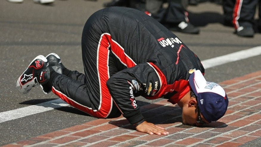 May 24, 2015: Juan Pablo Montoya, of Colombia, kisses the start/finish line after winning the 99th running of the Indianapolis 500 auto race at Indianapolis Motor Speedway in Indianapolis.