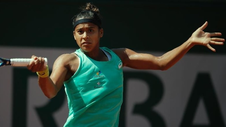 Brazil's Teliana Pereira returns in the first round match of the French Open tennis tournament against Fiona Ferro of France at the Roland Garros stadium, in Paris, France, Sunday, May 24, 2015. (AP Photo/Francois Mori)
